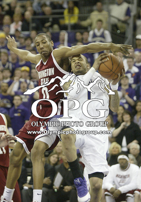 07 March 2009:  Washington State guard #0 Marcus Capers fouls Washington's #01 Venoy Overton as he goes up for a basket at the Bank of America Arena at Hec Edmundson Pavilion in Seattle, WA.  Washington won 67-60 over Washington State and captured the Pac-10 title for the first time in school history.
