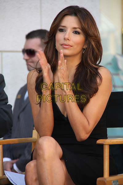 EVA LONGORIA PARKER.Kids with Cancer Press Conference held at the Glendale Galleria, Glendale, California, USA,.31st March 2009..half length black dress hands cleavage sitting in chair gold necklace clapping .CAP/ADM/KB.©Kevan Brooks/Admedia/Capital PIctures