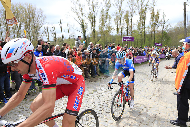 The breakaway group, including Aliaksander Kuchynski Katusha and Raymond Kreder (NED) Garmin Sharp, climb the Molenberg during the 2014 Tour of Flanders, Belgium.<br /> Picture: Eoin Clarke www.newsfile.ie