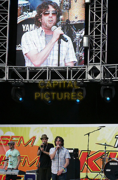 ELLIOTT YAMIN.Performing live on stage  at The 10th Annual KIIS FM Wango Tango 2007 held at Verizon Wireless Ampitheatre in Irvine, California, USA, May 12 2007..half length music gig concert microphone sunglasses tv screen.CAP/DVS.©Debbie VanStory/Capital Pictures
