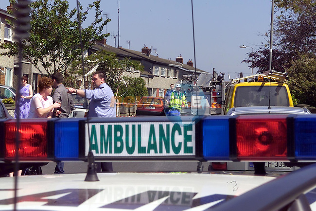 garda and Ambulance personel move people from there houses beside the explosion..No Byline..Picture Fran Caffrey Newsfile.