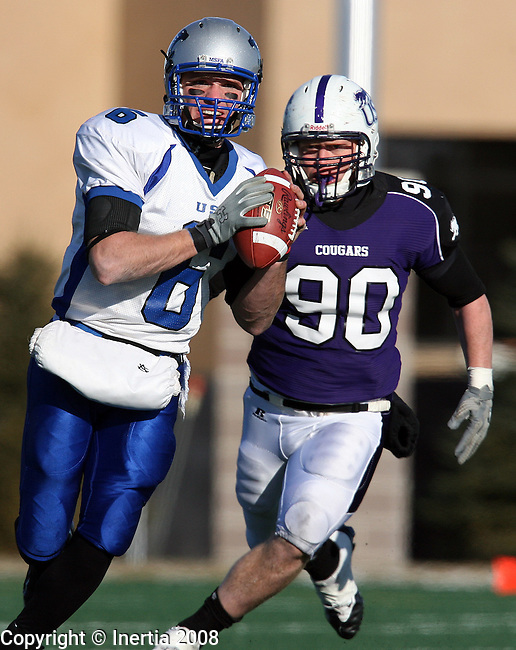 SIOUX FALLS, SD - DECEMBER 6:  Jeff Wedding #6 of the University of St. Francis looks downfield for a receiver as Brandon Koolstra #90 of the University of Sioux Falls closes in during the second quarter of their NAIA semifinal game Saturday afternoon at the USF Sports Complex in Sioux Falls.  (Photo by Dave Eggen/Inertia)