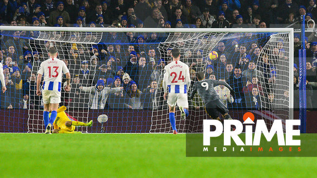 Jamie Vardy of Leicester City (9) Scores his teams 1st goal of the match from the equalising penalty kick  during the Premier League match between Brighton and Hove Albion and Leicester City at the American Express Community Stadium, Brighton and Hove, England on 24 November 2018. Photo by Edward Thomas / PRiME Media Images.