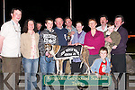 "CHAMPION: Champion dog Homestead Toy, winner of the 8th Race, the John ""Killeacle"" Dowling 570 Sweepstake Final at Kingdom Greyhound Stadium, Tralee, on Saturday evening, with his owner and handler who were presented with the John ""Killeacle"" Dowling Memorial Trophy by Mary Dowling. L-r: Kieran Casey, Joan Dowling, Damien Lynch (Handler), Dan Lynch (owner), Declan Dowling, Mary Dowling, Angela Dowling, Liam Dowling, Nicholas and Nicholas Dowling Jnr and Eamon Dowling.."