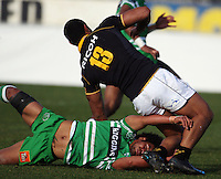 Manawatu centre Tavita Taufui tackles Robert Fruean during the Air NZ Cup preseason match between Manawatu Turbos and Wellington Lions at FMG Stadium, Palmerston North, New Zealand on Friday, 17 July 2009. Photo: Dave Lintott / lintottphoto.co.nz