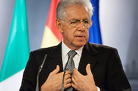 Mario Monti answers a question in a Hispanic-Italian meeting