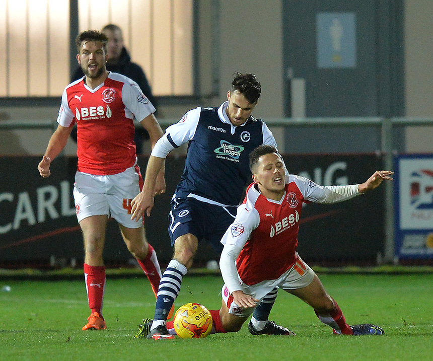 Fleetwood Town's Antoni Sarcevic is tackled by Millwall's Lee Gregory<br /> <br /> Photographer Dave Howarth/CameraSport<br /> <br /> Football - The Football League Sky Bet League One - Fleetwood Town v Millwall - Tuesday 24th November 2015 - Highbury Stadium<br /> <br /> &copy; CameraSport - 43 Linden Ave. Countesthorpe. Leicester. England. LE8 5PG - Tel: +44 (0) 116 277 4147 - admin@camerasport.com - www.camerasport.com