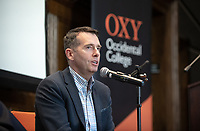 David Plouffe, policy and advocacy chief for The Chan Zuckerberg Initiative and former Obama campaign manager and White House senior advisor, talks in Occidental College's Choi Auditorium as the inaugural speaker in the College's new Obama Scholars Speakers Series, Oct. 19, 2018. Plouffe was joined by Clapp Distinguished Professor of Politics Peter Dreier and former California state senator and current Occidental trustee Hector De La Torre, who asked him a series of wide-ranging questions.<br /> The speakers series is part of the Obama Scholars Program, launched last year to empower exceptional students committed to the public good as it honors and perpetuates the principles President Barack Obama '83 has advanced throughout his life. Occidental welcomed its first two Obama Scholars with the Class of 2022 this fall.<br /> (Photo by Marc Campos, Occidental College Photographer)