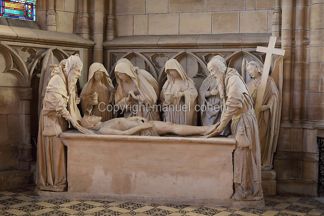 Entombment sculpture, with (left-right) Nicodemus, Virgin, St John, Mary Magdalene, Joseph of Arimathea, late 15th century, originally from the Cordeliers de Chalon Convent, transfered here during the French Revolution, in the Basilique Notre-Dame de l'Epine, or Basilica of Our Lady of the Thorn, L'Epine, Marne, Champagne-Ardenne, France. The church was built 1405-1527 in Flamboyant Gothic style, is listed as a historic monument and as a UNESCO World Heritage Site as part of the Santiago de Compostela pilgrimage site. Picture by Manuel Cohen