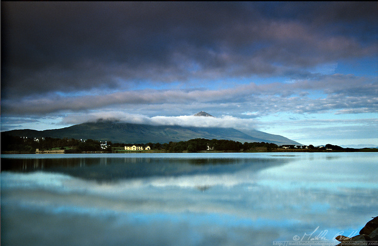 Early morning clouds on top Croagh Patrick looking across the Clew Bay, Westport, Mayo, Ireland