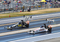 Jun 19, 2016; Bristol, TN, USA; NHRA top fuel driver Richie Crampton (near) races alongside Leah Pritchett during the Thunder Valley Nationals at Bristol Dragway. Mandatory Credit: Mark J. Rebilas-USA TODAY Sports