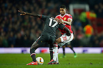 Marcus Rashford of Manchester United battles Mamadou Sakho of Liverpool during the UEFA Europa League match at Old Trafford. Photo credit should read: Philip Oldham/Sportimage