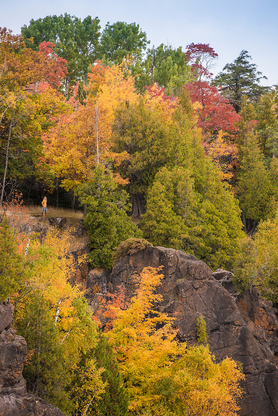 Fall foliage and cliffs over Lake Superior at Presque Isle Park, Marquette, Michigan.
