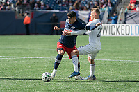 FOXBOROUGH, MA - MARCH 7: Gustavo Bou #7 of New England Revolution breaks free of a tackle by Fabian Herbers #21 of Chicago Fire during a game between Chicago Fire and New England Revolution at Gillette Stadium on March 7, 2020 in Foxborough, Massachusetts.