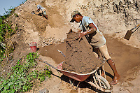 Moisés, a thirteen-year-old Salvadoran boy, fills wheelbarrow with clay for brick making at a brick factory in Istahua, El Salvador, 21 December 2013. Child labour is a common practice at the artisanal brick factories, found mainly in rural areas of El Salvador. Poverty and insufficient earnings in agriculture force parents to employ their own children, in an effort to ensure the livelihood for the whole family. Children aged 8-10 are allowed to work slower, with smaller volumes of clay, while children aged 12 and up work regularly, 8-10 hours a day, 6 days a week.