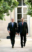 "Baghdad, Iraq - June 13, 2006 -- United States President George W. Bush, left, walks with Prime Minister Nouri al-Maliki of Iraq in the courtyard of the U.S. Embassy in Baghdad, Iraq, Tuesday, June 13, 2006. Bush assured Iraqis in a surprise visit to Baghdad on Tuesday that the United States stands with them and their new government, saying ""It's in our interest that Iraq succeed."" <br /> Credit: Eric Draper - White House via CNP"