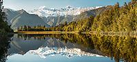 Stunning morning winter reflections of Mount Tasman and  Aoraki, Mount Cook of Southern Alps in Lake Matheson, Westland Tai Poutini National Park, West Coast, UNESCO World Heritage Area, South Westland, New Zealand, NZ