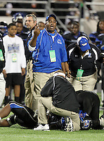 First Coast Buccaneers assistant coach questions a call as an injured player is looked at during the Florida High School Athletic Association 7A Championship Game at Florida's Citrus Bowl on December 16, 2011 in Orlando, Florida.  Manatee defeated First Coast 40-0.  (Mike Janes/Four Seam Images)