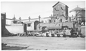 Engineer side view of K-37 #490 with sand tower and water tank in background.<br /> D&amp;RGW  Salida, CO  7/15/1949