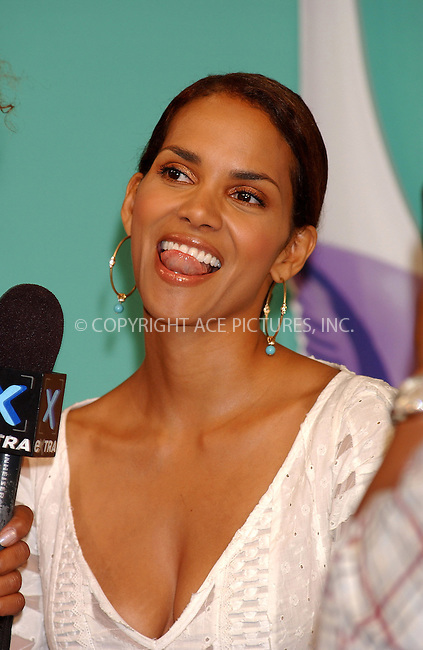 WWW.ACEPIXS.COM . . . . . ....NEW YORK, JULY 13, 2005....Halle Berry on hand to present a donation $150,000 to the American Heart Association to coincide with the launch of the new Oral B Pulsar Toothbrush at Times Square Studios.....Please byline: KRISTIN CALLAHAN - ACE PICTURES.. . . . . . ..Ace Pictures, Inc:  ..Craig Ashby (212) 243-8787..e-mail: picturedesk@acepixs.com..web: http://www.acepixs.com