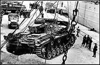BNPS.co.uk (01202 558833)Pic:    Pen&Sword/BNPS<br /> <br /> A German Panzer tank being unloaded from a transport ship.<br /> <br /> Fascinating rare photos of Rommel's feared Afrika Korps which terrorised the Allies in the desert have come to light in a new book.<br /> <br /> Under the direction of legendary German commander Field Marshal Erwin Rommel, who was nicknamed the Desert Fox, the corps were recognised as a superb fighting machine.<br /> <br /> They achieved their greatest triumph when they outmanoeuvred the British at the Battle of Gazala in June 1942 which led to them capturing Tobruk in Libya.<br /> <br /> But they were ultimately defeated in the iconic Battle of Alamein when they succumbed to an offensive led by Field Marshal Bernard Montgomery.