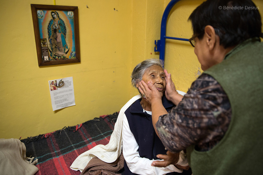 Elia, a resident of Casa Xochiquetzal, applies facial moisturizer on Josée at the shelter in Mexico City, Mexico on February 10, 2017. Casa Xochiquetzal is a shelter for elderly sex workers in Mexico City. It gives the women refuge, food, health services, a space to learn about their human rights and courses to help them rediscover their self-confidence and deal with traumatic aspects of their lives. Casa Xochiquetzal provides a space to age with dignity for a group of vulnerable women who are often invisible to society at large. It is the only such shelter existing in Latin America. Photo by Bénédicte Desrus