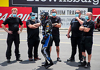 Jul 10, 2020; Clermont, Indiana, USA; NHRA top fuel driver Tony Schumacher (center) talks with crew members wearing face masks during testing for the Lucas Oil Nationals at Lucas Oil Raceway. This will be the first race back for NHRA since the COVID-19 pandemic. Mandatory Credit: Mark J. Rebilas-USA TODAY Sports