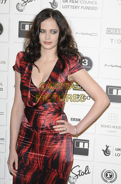 EVA GREEN .Attending The British Independent Film Awards,The Brewery, London, England, UK, December 6th 2009. .arrivals half length red and black feather print Alexander McQueen dress silk satin hand on hip low cut cleavage shoulder pads.CAP/CAN.©Can Nguyen/Capital Pictures