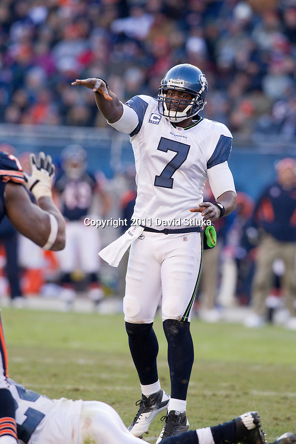 Seattle Seahawks quarterback Tarvaris Jackson (7) throws a touchdown pass during a week 15 NFL football game against the Chicago Bears on December 18, 2011 in Chicago. The Seahawks won 38-14. (AP Photo/David Stluka)
