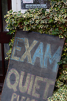 Exam sign, Summerhill School, Leiston, Suffolk. The school was founded by A.S.Neill in 1921 and is run on democratic lines with each person, adult or child, having an equal say.  You don't have to go to lessons if you don't want to but could play all day.  It gets above average GCSE exam results.