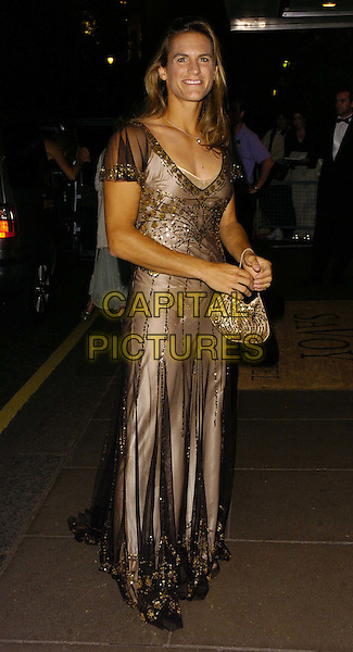 AMELIE MAURESMO.At the Wimbledon Champions Dinner, The Savoy Hotel, London, England, July 9th 2006..full length gold beaded brown black sheer see through thru layered dress purse bag.Ref: CAN.www.capitalpictures.com.sales@capitalpictures.com.©Can Nguyen/Capital Pictures