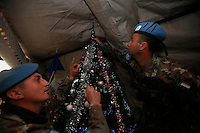 Two soldiers from the  Montebello Squadron, Fifth  Lancieri of Novara regiment of the Italian Cavalry prepare a Christmas tree shipped from Italy  in the UNIFIL Chama base in Southern Lebanon on Friday Dec 08 2006..Close to 1000 Italian peacekeepers operate in  the in Southern lebanon town of Chama, constantly patrolling their sector in search for illegal weapons in the country.