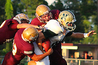 Nease running back Jared Bassett, right, struggles to break free from St. Augustine's defense during the first quarter of Friday night football action at St. Augustine. St. Augustine triumphed 36-14 on their home field.