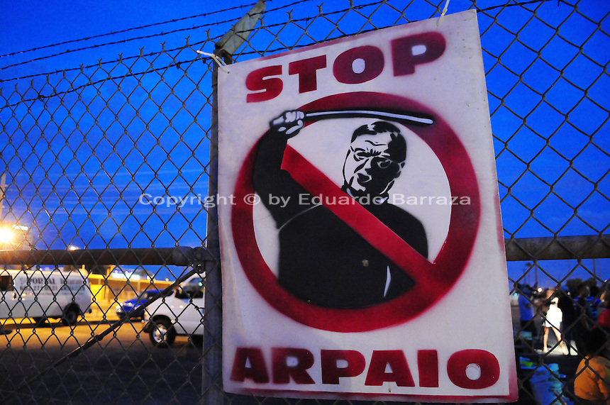 "Phoenix, Arizona. September 22, 2012 - An iconic poster against Maricopa County Sheriff Joe Arpaio with his likeness and portrayed as an abuser of his authority is seen on display on the fence of the lot where the ""Festival of Resistance"" was held. Photo by Eduardo Barraza © 2012"