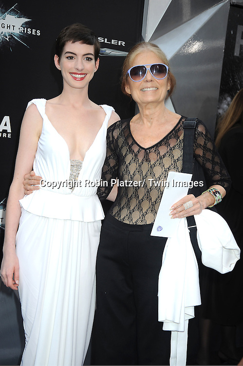 "Anne Hathaway in long white dress and Gloria Steinem attends the world premiere of ""The Dark Knight Rises"" on .July 16, 2012 at The AMC Lincoln Square Imax Theatre in New York City. The movie stars Christian Bale, Gary Oldman, Anne Hathaway, Tom Hardy, Marion Cotillard, Joseph Gordon-Levitt and Morgan Freeman."