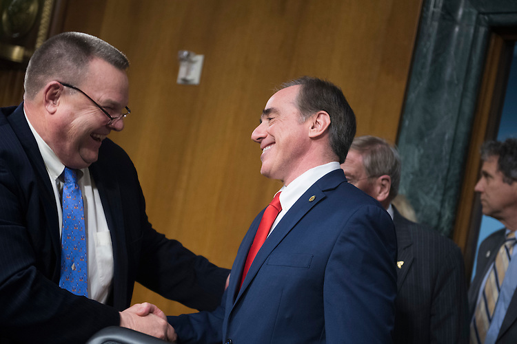 UNITED STATES - FEBRUARY 01: David Shulkin, nominee for Veterans Affairs secretary, right, greets Ranking Member Jon Tester, D-Mont., before his Senate Veterans' Affairs Committee confirmation hearing in Dirksen Building, February 1, 2017. (Photo By Tom Williams/CQ Roll Call)