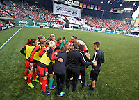 Portland, Oregon - Sunday April 17, 2016: Portland Thorns FC huddle before the start of the match. The Portland Thorns play the Orlando Pride during a regular season NWSL match at Providence Park.