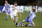 16 November 2007: North Carolina's Garry Lewis (8) tackles the ball away from Wake Forest's Corben Bone (10). Wake Forest University played the University of North Carolinaat SAS Stadium in Cary, NC in an Atlantic Coast Conference Men's Soccer tournament semifinal.