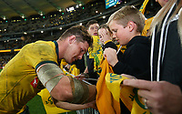 Michael Hooper of the Wallabies signs autographs for fans during the Rugby Championship match between Australia and New Zealand at Optus Stadium in Perth, Australia on August 10, 2019 . Photo: Gary Day / Frozen In Motion
