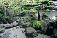 This Zen garden landscape of stones, pines and a dry stream is one of the most famous Japanese garden arramngements in Kyoto. It is located at the Daisen-in within the  larger temple complex of Daitokuji.