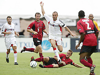 26 June 2004:   DC United Earnie Stewart in action against Dallas Burn defenders at Cotton Bowl in Dallas, Texas.   DC United and Dallas Burn are tied 1-1 after the game.   Credit: Michael Pimentel / ISI