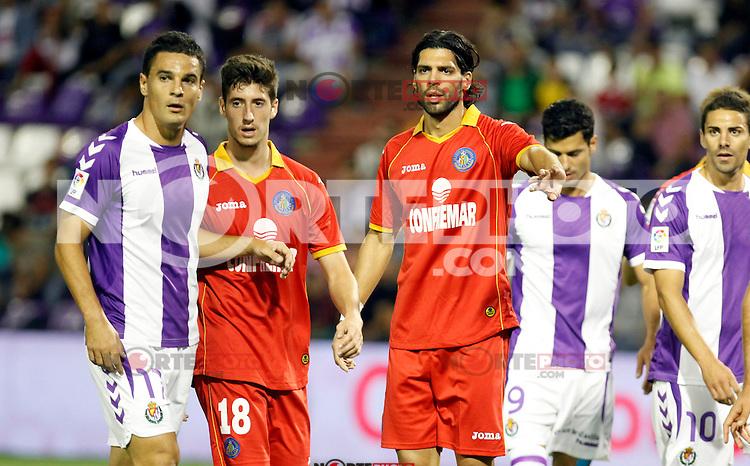 Real Valladolid´s Peña (l) and Javi Guerra (r) and Getafe's Escudero and Lafita during La Liga match.August 31,2013. (ALTERPHOTOS/Victor Blanco)