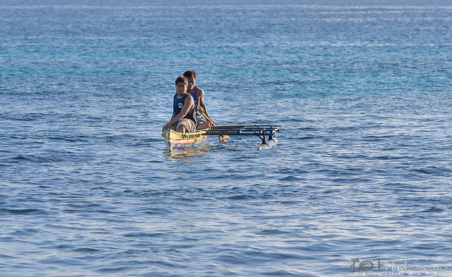 Paddling a traditional canoe on the island of Kiritimati in Kiribati.