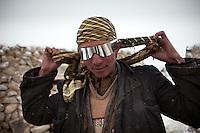 Abdul Sator's new glasses..Camp of Ortobil, Manara (Sufi camp), near the borders with China and Tajikistan...Trekking with yak caravan through the Little Pamir where the Afghan Kyrgyz community live all year, on the borders of China, Tajikistan and Pakistan.