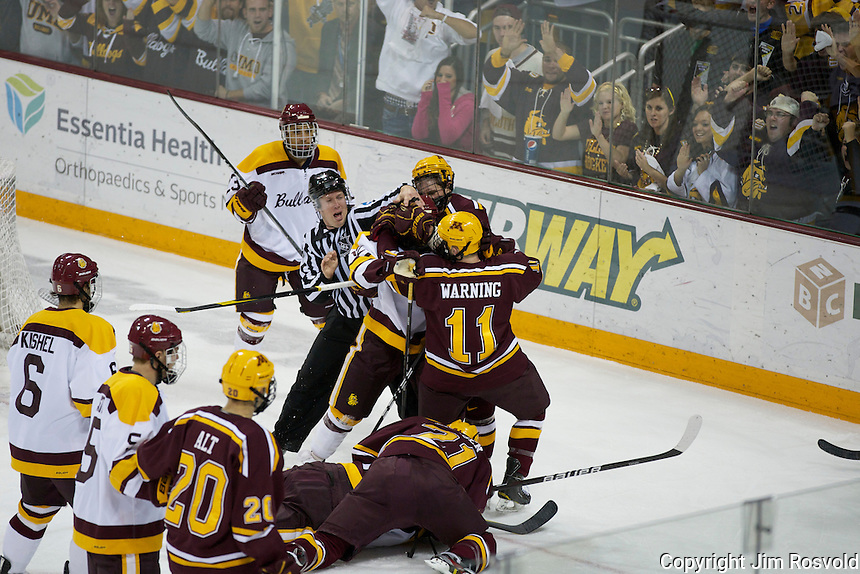 14 Oct 11: Tony Czech (WCHA Referee), Sam Warning (Minnesota -11) The University of Minnesota-Duluth Bulldogs host the University of Minnesota Golden Gophers in a WCHA matchup at Amsoil Arena in Duluth, MN.
