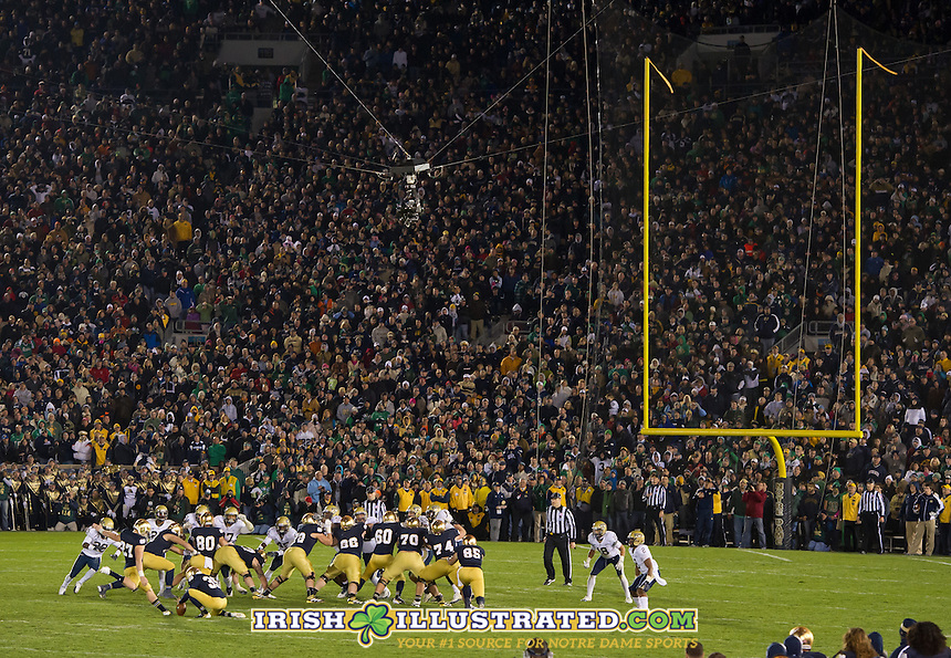 Kicker Kyle Brindza (27) keeps the Irish alive with a field goal in overtime.