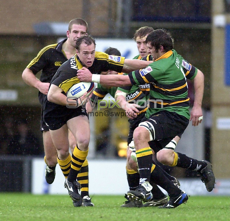 Pix: Matthew Lewis/SWpix.com. Rugby Union. Zurich premiership. London Wasps v Northampton Saints. 2/02/2003...COPYRIGHT PICTURE>>SIMON WILKINSON>>01943 436649>>..Wasps' Mark Van Gisbergen is tackled by Northampton's Matt Lord.