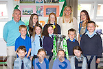 Irish Rugby heroine Siobhain Fleming brought the Grand Slam trophy to former school Currow NS on Wednesday front row l-r: Adam Healy, Danielle Huggard. Middle row: Brian Roche, Fiona Brosnan, Emma Mitchell, Cathal Darragh Kelly. Back row: Weeshie Fogarty, Aoife O'Sullivan, Ellie Daly, Siobhain Fleming and Kate McSweeney