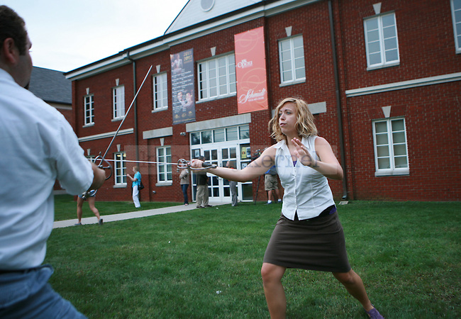 vocal performance senior Melissa Snow-Groves fights vocal performance sophomore Jacob Waid on the lawn of the Schmidt Vocal Arts Center in Lexington, Ky., Sept. 14, 2011. Photo by Brandon Goodwin | STAFF