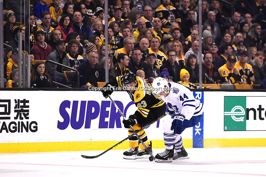 Saturday, November 21, 2015: Boston Bruins left wing Brad Marchand (63) plays the puck in front of Toronto Maple Leafs defenseman Morgan Rielly (44) during the National Hockey League game between the Toronto Maple Leafs and the Boston Bruins held at TD Garden, in Boston, Massachusetts. Boston defeats Toronto 2-0 in regulation time. Eric Canha/CSM
